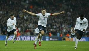 Steven Gerrard celebrates scoring England's second goal against Poland and sending the Three Lions to the World Cup.