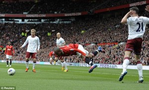 Falling down: Young takes a tumble against former club Aston Villa