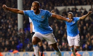 Vincent Kompany celebrates scoring City's fifth in a 5-1 victory at White Hart Lane