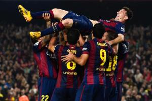 Lionel Messi of FC Barcelona celebrates with his teammates after setting Spanish goal scoring record.