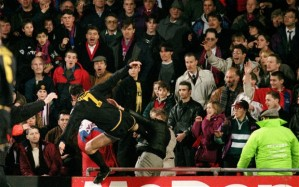 Kicking out: Eric Cantona received a lengthy ban for this kick on Crystal Palace fan Matthew Simmons exactly 20 years ago on 25th January, 1995